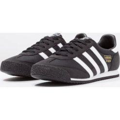 Adidas Originals DRAGON OG  Tenisówki i Trampki core black/white. Czarne tenisówki męskie marki adidas Originals, z materiału, klasyczne. W wyprzedaży za 188,30 zł.