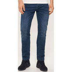 Jeansy slim - Granatowy. Niebieskie jeansy męskie slim marki House. Za 139,99 zł.