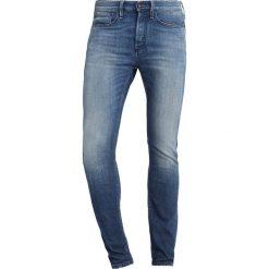 Denham BOLT Jeans Skinny Fit left hand lisbon. Niebieskie rurki męskie Denham, z bawełny. Za 759,00 zł.