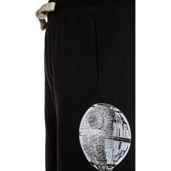 GAP BOYS ACTIVE ARCH  Spodnie treningowe true black. Czarne spodnie dresowe dziewczęce GAP, z bawełny. Za 129,00 zł.