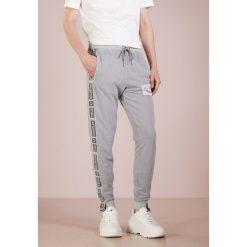 True Religion TAPE PANT Spodnie treningowe lime stone. Szare spodnie dresowe męskie True Religion, z bawełny. Za 629,00 zł.