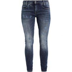 GStar DSTAQ 5PKT MID SKINNY  Jeans Skinny Fit trender ultimate stretch denim. Szare jeansy damskie marki G-Star. W wyprzedaży za 391,30 zł.
