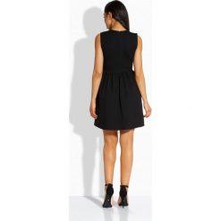Sukienki: Kobieca sukienka ze złotymi guziczkami czarny