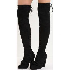 Czarne Kozaki Be Like Minnie. Czarne buty zimowe damskie marki Born2be, z okrągłym noskiem, na wysokim obcasie, na słupku. Za 119,99 zł.
