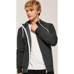 Rozpinana bluza basic - Zielony. Czarne bluzy męskie rozpinane marki KIPSTA, z poliesteru, do piłki nożnej. Za 79,99 zł.
