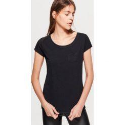Gładka koszulka - Czarny. Białe t-shirty damskie marki KALENJI, z materiału, z dekoltem na plecach. Za 19,99 zł.