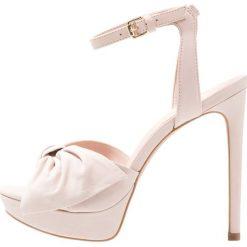 ALDO SUBLIMITY Sandały na obcasie light pink. Czerwone sandały damskie ALDO, z materiału, na obcasie. Za 459,00 zł.