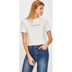 Calvin Klein Jeans - Top. Szare topy damskie Calvin Klein Jeans, l, z aplikacjami, z bawełny, z okrągłym kołnierzem. Za 229,90 zł.