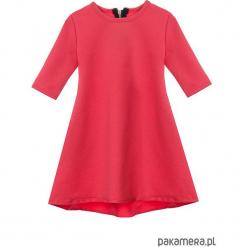 Sukienka dresowa dziecięca typu klosz koral. Czerwone sukienki dziewczęce marki Pakamera, z dresówki. Za 69,00 zł.