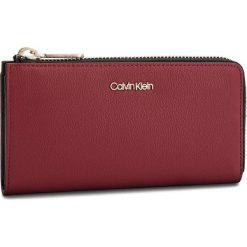 Duży Portfel Damski CALVIN KLEIN - Drive Large Zip Arou K60K604503 628. Czerwone portfele damskie Calvin Klein, ze skóry ekologicznej. Za 299,00 zł.
