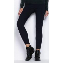 Granatowe Spodnie Across The Line. Czarne rurki damskie marki Born2be, l. Za 34,99 zł.