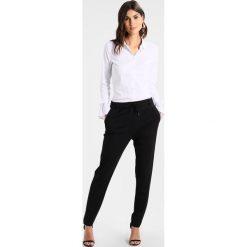 Comma Spodnie treningowe black. Czarne spodnie dresowe damskie comma, z dresówki. Za 379,00 zł.