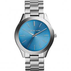 """Zegarek kwarcowy """"Slim Runway"""" w kolorze srebrno-niebieskim. Szare, analogowe zegarki damskie marki Michael Kors, ze stali. W wyprzedaży za 367,95 zł."""