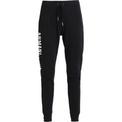 Armani Exchange Spodnie treningowe black. Czarne spodnie dresowe damskie Armani Exchange, s, z bawełny. W wyprzedaży za 351,20 zł.