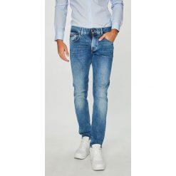 Tommy Hilfiger - Jeansy Bleecker. Szare jeansy męskie marki TOMMY HILFIGER, m, z nadrukiem, z bawełny, casualowe, z okrągłym kołnierzem. Za 499,90 zł.