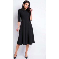 Czarna Sukienka Wizytowa Midi z Szerokim Dołem. Czarne sukienki balowe marki bonprix, do pracy, w paski, moda ciążowa. Za 129,90 zł.