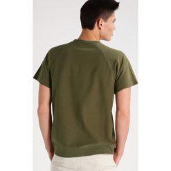 Brixton CODY Tshirt basic olive. Zielone koszulki polo marki Brixton, m, z bawełny. W wyprzedaży za 134,50 zł.
