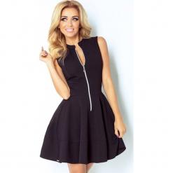 123-3 sukienka z ekspresem z przodu i kieszonkami - cegiełka czarna. Czarne długie sukienki marki numoco, l, z długim rękawem, oversize. Za 139,00 zł.