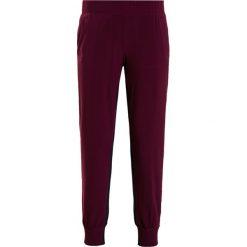 Norma Kamali SIDE STRIPE Spodnie treningowe midnight/plum/ivory. Czarne bryczesy damskie marki Norma Kamali, s, z elastanu. W wyprzedaży za 510,95 zł.