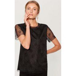 Koszulka z tiulem - Czarny. Czarne t-shirty damskie marki Mohito, l, z tiulu. Za 69,99 zł.