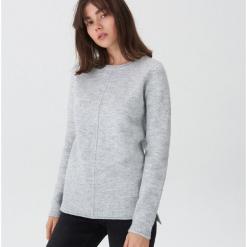 Sweter - Jasny szar. Czarne swetry klasyczne damskie marki KIPSTA, z poliesteru, do piłki nożnej. Za 79,99 zł.