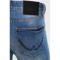Jeansy męskie: Superdry Jeansy Slim Fit cali vintage blue