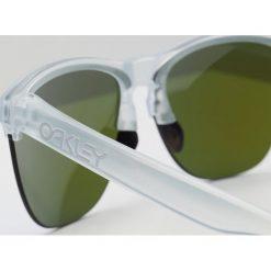 Oakley FROGSKINS LITE Okulary przeciwsłoneczne violet iridium. Białe okulary przeciwsłoneczne damskie lenonki marki Oakley. Za 509,00 zł.