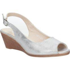 Srebrne sandały błyszczące na koturnie Sergio Leone SK811-22S. Czarne sandały damskie marki Sergio Leone. Za 88,99 zł.