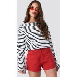 Trendyol Szorty jeansowe z surowym wykończeniem - Red. Czerwone bermudy damskie Trendyol, z jeansu. W wyprzedaży za 56,67 zł.