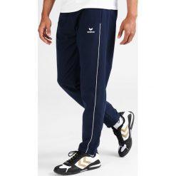 Chinosy męskie: Erima Spodnie materiałowe new navy/white