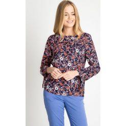 Granatowa bluzka w kwiatowy wzór QUIOSQUE. Brązowe bluzki asymetryczne QUIOSQUE, z wiskozy, biznesowe, z asymetrycznym kołnierzem. W wyprzedaży za 39,99 zł.