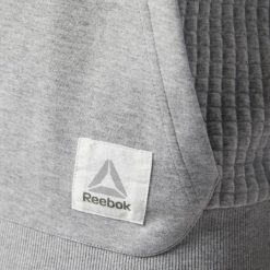 BLUZA REEBOK QUILTED CD9283. Szare bluzy męskie marki Reebok, l, z dzianiny, z okrągłym kołnierzem. Za 199,00 zł.