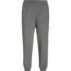 Puma ESSENTIALS Spodnie treningowe medium gray heather. Różowe spodnie chłopięce marki Puma, na lato, z tkaniny, sportowe. Za 129,00 zł.