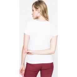 Calvin Klein Jeans - Top. Szare topy damskie marki Calvin Klein Jeans, l, z bawełny, z okrągłym kołnierzem. W wyprzedaży za 99,90 zł.