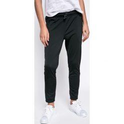 Adidas Originals - Spodnie EQT Cigarette. Szare chinosy damskie adidas Originals, z materiału. W wyprzedaży za 239,90 zł.