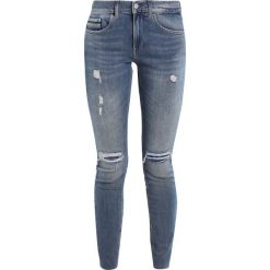Calvin Klein Jeans MID RISE SKINNY ANKLE RAW Jeans Skinny Fit thermal. Szare jeansy damskie marki Calvin Klein Jeans, z bawełny. W wyprzedaży za 449,25 zł.