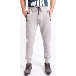 Spodnie dresowe męskie: Spodnie dresowe męskie SPMD255z - jasny szary melanż