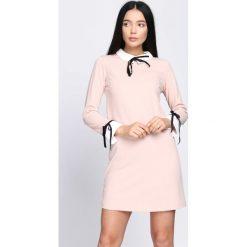 Jasnoróżowa Sukienka Too Original. Różowe sukienki koktajlowe marki numoco, l, z dekoltem w łódkę, oversize. Za 49,99 zł.