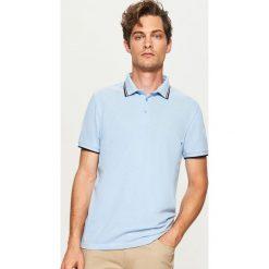 Koszulka polo - Niebieski. Niebieskie koszulki polo marki Reserved, l. W wyprzedaży za 49,99 zł.
