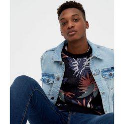 Kurtka jeansowa z efektem sprania. Niebieskie kurtki męskie jeansowe marki Reserved, l. Za 119,00 zł.
