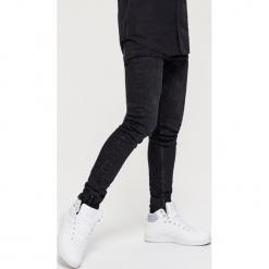 Jeansy SKINNY - Czarny. Czarne jeansy męskie regular Cropp. Za 119,99 zł.