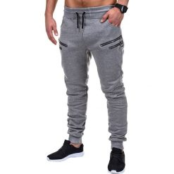 SPODNIE MĘSKIE DRESOWE P422 - SZARE. Szare spodnie dresowe męskie marki Ombre Clothing, z bawełny. Za 39,00 zł.