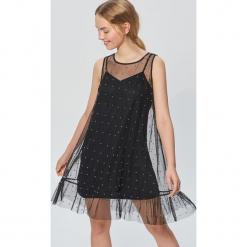 Sukienka ze sztucznymi perłami - Czarny. Czarne sukienki marki Cropp, l. Za 89,99 zł.
