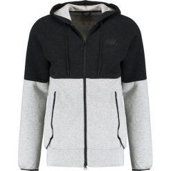 New Balance Bluza rozpinana athletic grey. Szare bluzy męskie rozpinane marki New Balance, m, z bawełny. W wyprzedaży za 381,75 zł.