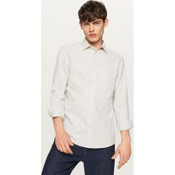 Bawełniana koszula regular fit - Jasny szar. Szare koszule męskie marki Reserved, l, z bawełny. W wyprzedaży za 49,99 zł.