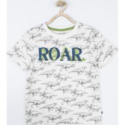 Koszulka. Białe t-shirty chłopięce z długim rękawem DINOSAUR, z aplikacjami, z bawełny. Za 39,90 zł.