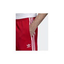 Spodnie treningowe adidas  Spodnie dresowe SST. Czerwone spodnie dresowe męskie marki Criminal Damage, z elastanu. Za 279,00 zł.