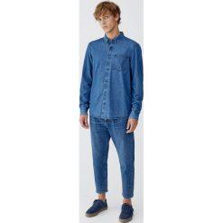 Jeansy relaxed fit. Czarne jeansy męskie relaxed fit marki Pull&Bear, m. Za 139,00 zł.