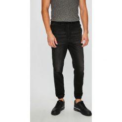 Jack & Jones - Jeansy. Czarne jeansy męskie z dziurami marki Jack & Jones, l, z bawełny, z okrągłym kołnierzem. Za 259,90 zł.