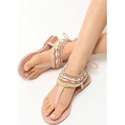 Różowe Sandały Retiary. Czerwone sandały damskie marki Born2be, z materiału, na płaskiej podeszwie. Za 59,99 zł.